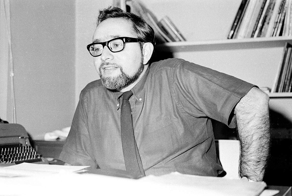 Irwin Silber at his desk in the Folkways Records office.
