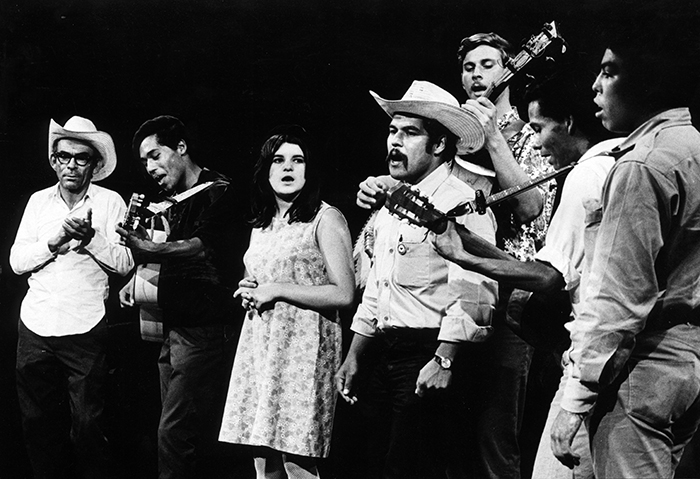 "Members of the Chicana/Chicano theater group El Teatro Campesino singing ""De Colores"" during the Grape Strike. Photo by Diana Davies. Courtesy of the Ralph Rinzler Folklife Archives and Collections."