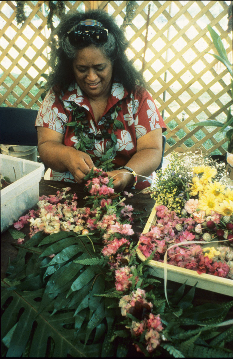 Pualani Kanaka'ole Kanahele creates a lei at the 1989 Smithsonian Folklife Festival. Photo by Dane Harwood. Courtesy of the Ralph Rinzler Folklife Archives and Collections, Smithsonian Institution.