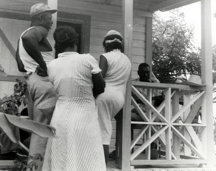 Joseph Spence at his home in the Bahamas with friends listening in.