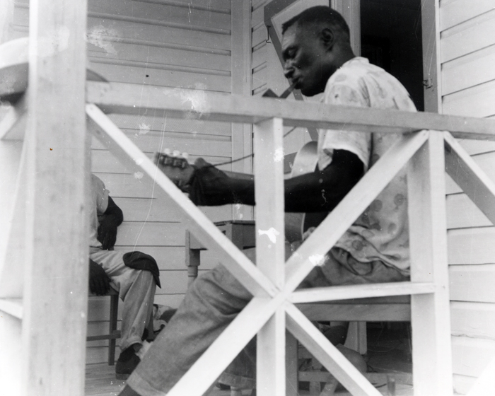 Joseph Spence performs at his home in the Bahamas.