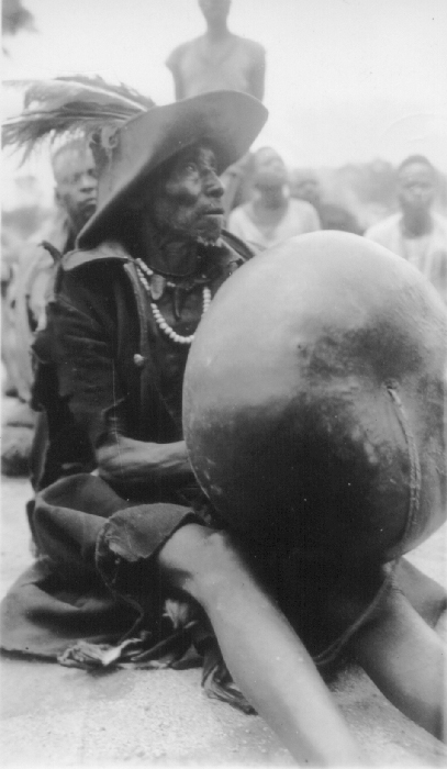 Shona/Budya people, Zimbabwe. Kadori playing a Madebe dza Mhondoro mbira, Mutoko district.