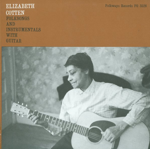"Elizabeth Cotten wrote the classic song ""Freight Train"" when she was a child. As the photograph shows and Mike Seeger's liner notes explain, ""Elizabeth Cotten picks the regular guitar and banjo upside down, or left-handed, using country ragtime style...and a banjo strum"" on both instruments and ""the first string as thumb string."""