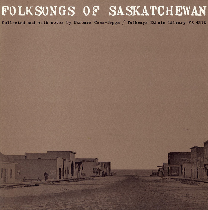 "The stark expanse of prairie sky dominates and serves as a backdrop for worn, degraded ""typewriter"" letterforms. The low horizontal format of the photograph superimposed on a taupe ground evokes the isolation of a prairie town. This photograph, taken in 1913, is of Vanguard, Saskatchewan."