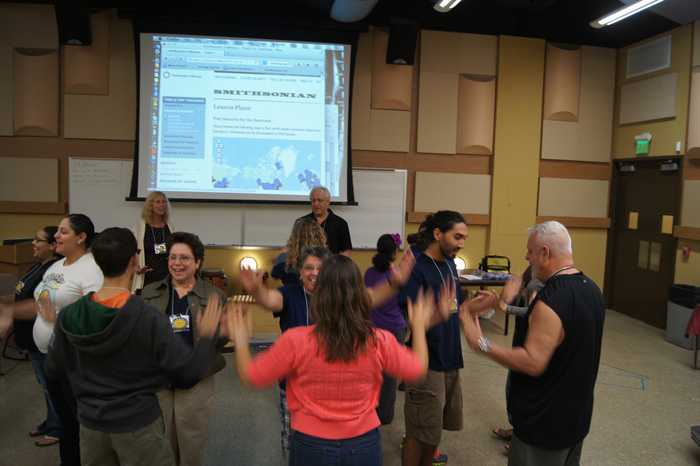 "The ""World Music Pedagogy: Illustrating the Issues"" workshop, held on September 28, 2013. Patricia Shehan Campbell presented strategies for integrating world music into curricular programs. Here, the members experienced strategies through active participation in traditional folk song hand games such as ""Epo I Tai Tai E"" from New Zealand."