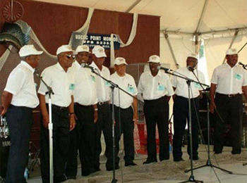 The Northern Neck Chantey Singers from Northumberland and Lancaster Counties, Virginia, performing at the 2004 Smithsonian Folklife Festival. They are a group of retired menhaden fishermen who sing some of the chatneys that helped ease the work of pulling up heavy nets.