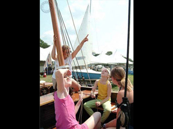 Visitors to the Folklife Festival imagine themselves sailing on the high seas, while sitting in a model tall ship owned by the National Maritime Heritage Foundation based in Washington, D.C.