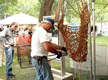 Delaware Bay fisherman Scott Shepard repairs an oyster dredge at the 2004 Smithsonian Folklife Festival.