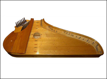 A modern Finnish kantele. Players place the instrument on their lap or a small table and either pluck or strum the strings to produce its distinctive bell-like sound.
