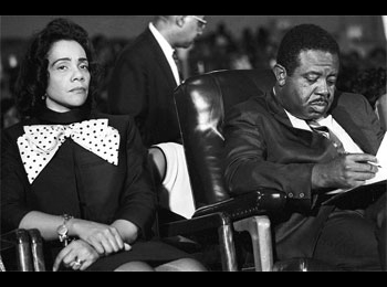 Coretta Scott King, widow of Martin Luther King, sits next to the Rev. Ralph Abernathy, King's successor as leader of the Southern Christian Leadership Conference, at a rally prior to the start of the Poor People's Campaign in Memphis, Tennessee, May 1, 1968.