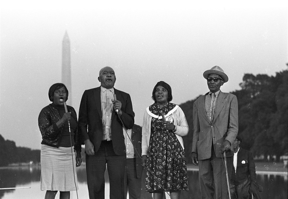 The Georgia Sea Island Singers perform at the Reflecting Pool in Washington, D.C. during the Poor People's Campaign, May-June 1968.