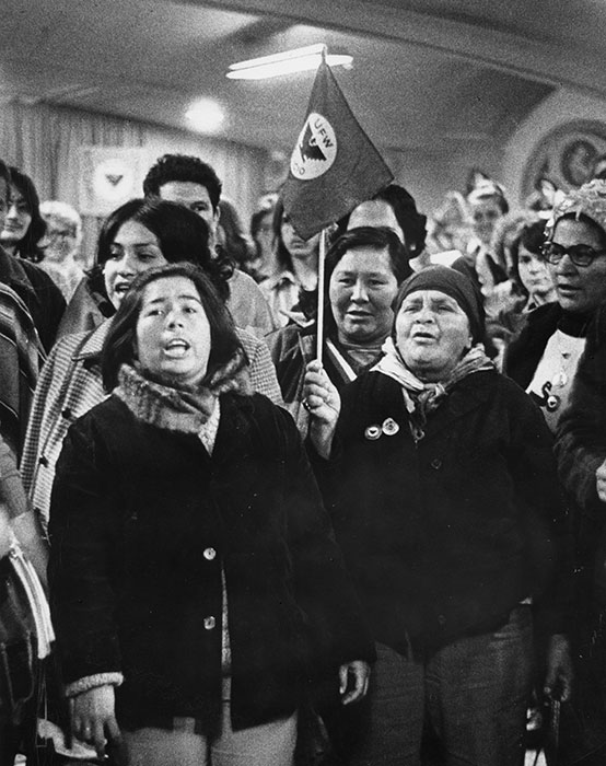 Women of the United Farm Wokers singing at a rally in the early 1970s.