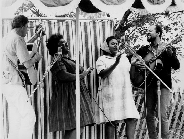 Guy Carawan, Fannie Lou Hamer, Bernice Johnson Reagon, and Len Chandler perform civil rights songs at the 1965 Newport Folk Festival. Photo by Diana Davies, Ralph Rinzler Folklife Archives