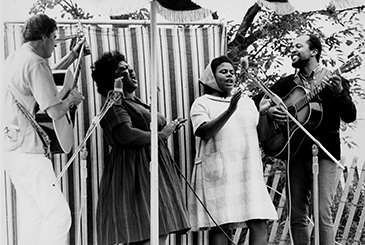 Guy Carawan, Fannie Lou Hamer, Bernice Johnson Reagon, and Len Chandler perform civil rights songs at the 1965 Newport Folk Festival.