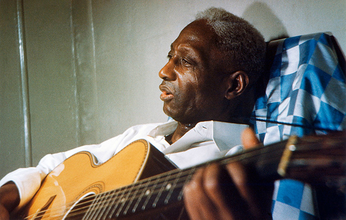 Portrait in New York, in Lead Belly's final days, 1948-49. Photo by Dr. Richard S. Blacher, courtesy Smithsonian Folkways and Lead Belly Estate, All Rights Reserved.